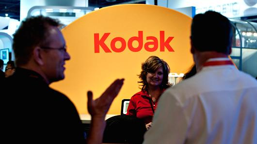 Attendees talk to a company representative in the Eastman Kodak booth at an International Consumer Electronics Show.
