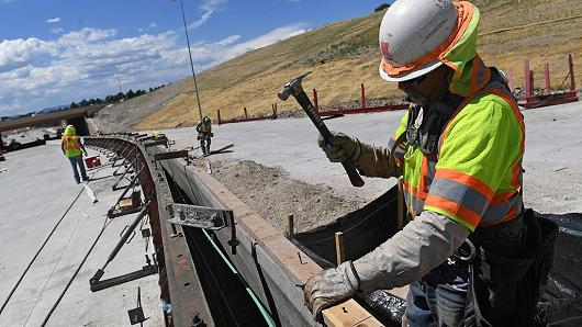 Sergio Hernandez works on the median just east of the new I-25 interchange in Castle Rock, Colorado.