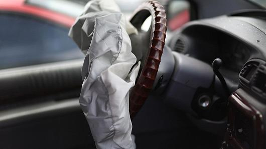 A deployed airbag is seen in a Chrysler vehicle at the LKQ Pick Your Part salvage yard on May 22, 2015 in Medley, Florida. The largest automotive recall in history centers around the defective Takata Corp. air bags that are found in millions of vehicles that are manufactured by BMW, Chrysler, Daimler Trucks, Ford, General Motors, Honda, Mazda, Mitsubishi, Nissan, Subaru and Toyota.