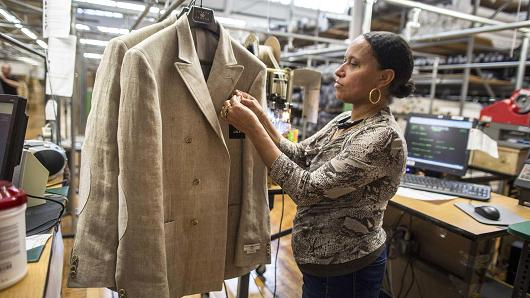 An employee attaches a tag to a jacket at the Joseph Abboud Manufacturing facility in New Bedford, Massachusetts.