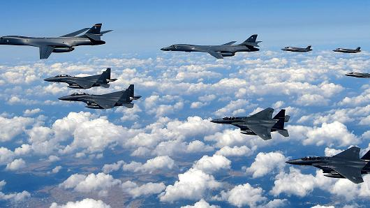 In this handout image provided by South Korean Defense Ministry, U.S. Air Force B-1B Lancer bombers flying with F-35B fighter jets and South Korean Air Force F-15K fighter jets during a training at the Pilsung Firing Range on September 18, 2017 in Gangwon-do, South Korea.