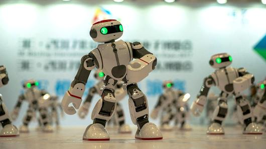 Robots dance during a consumer electronics expo at the Beijing China National Convention Center on Jul. 8, 2017 in Beijing, China.