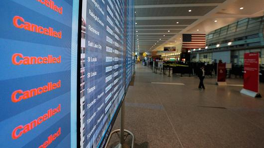A notice board shows cancelled flights at Logan International Airport during a winter snow storm in Boston, Massachusetts, U.S., January 4, 2018.