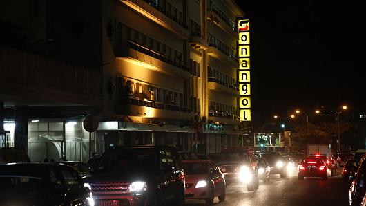 The logo for Sonangol, Angola's state oil company, illuminated above passing traffic in the capital Luanda on November 7, 2013.