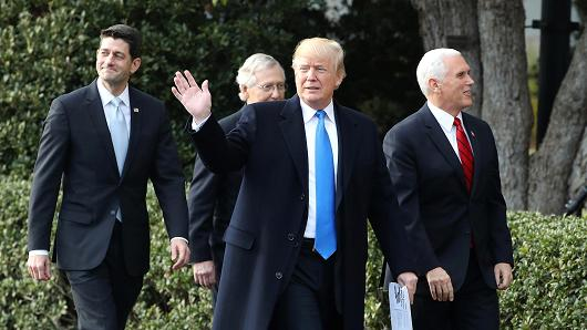 President Donald Trump (C), House Speaker Paul Ryan (R-WI) (L), Senate Majority Leader Mitch McConnell (R-KY) (2nd L) and Vice President Mike Pence make their way to a news conference announcing Congress passing the Tax Cuts and Jobs Act on the South Lawn of the White House on December 20, 2017 in Washington, DC.