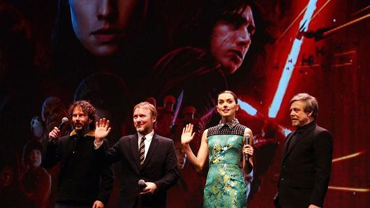 """Producer Ram Bergman, director Rian Johnson, actress Daisy Ridley and actor Mark Hamill (L-R) pose for pictures at the Chinese premiere of """"Star Wars: The Last Jedi"""" at the Shanghai Disney Resort on Dec. 20, 2017."""